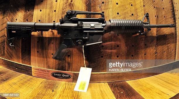 "An AR-15 rifle to be raffled off, is seen at the ""Wall of Guns,"" during the 142nd annual National Rifle Association Convention at the George R. Brown..."