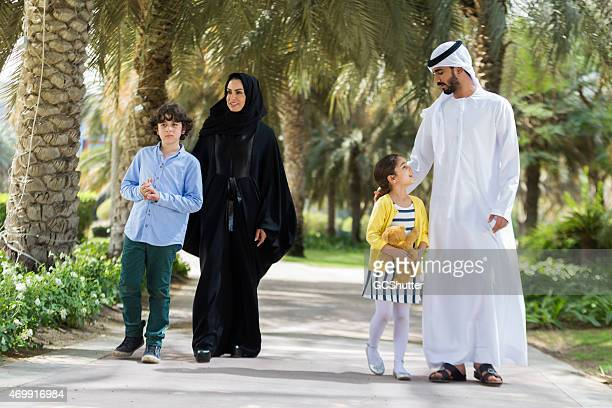 An Arab family with their children walking in the park