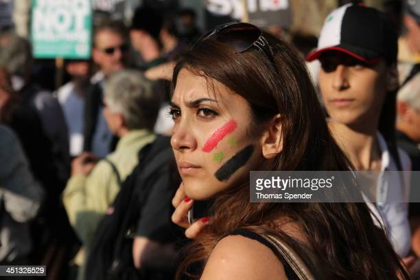 An Arab girl with a Syrian flag painted on her cheek at a demonstration outside Downing Street against a British military strike on Syria in response...
