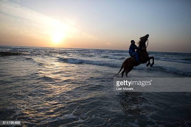 An Arab Israeli man rides a horse on the beach on March 7 2016 in the Arab Israeli Town of Jisr az Zarqa Israel Jisr azZarqa is the only remaining...