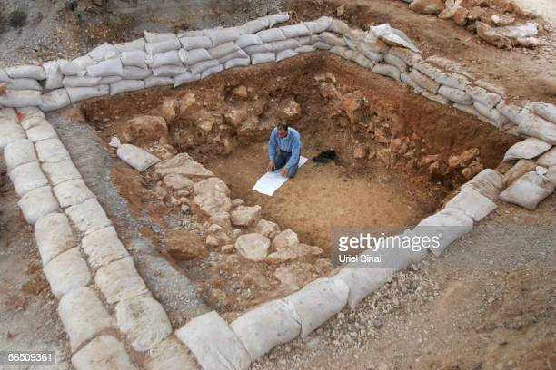 An Arab laborer prays as he works at an archaeological dig uncovering the remains of a large Jewish settlement dating from the time of the Second...