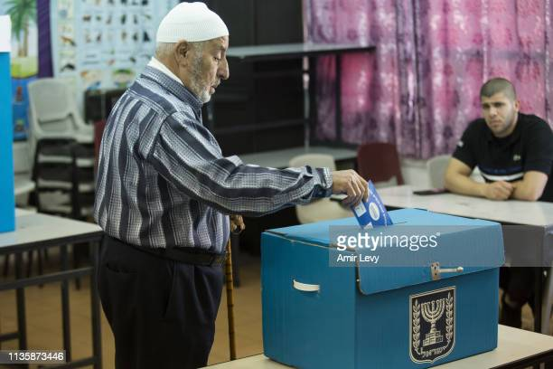 An Arab man casts his ballot in Israel's general elections on April 9 2019 in the village of Kafir Qasim Israel