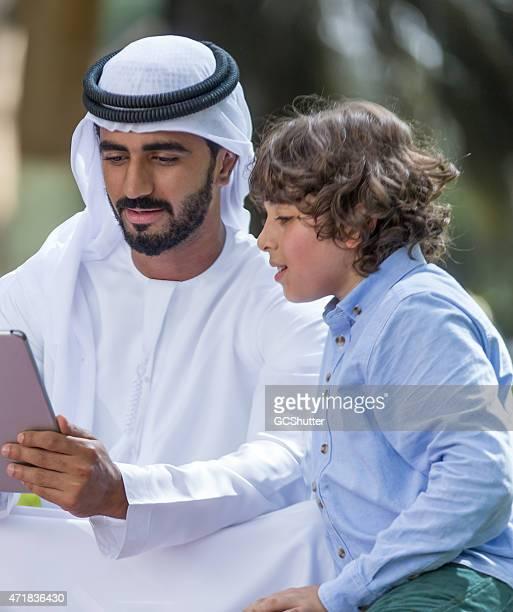 An Arab man with his son