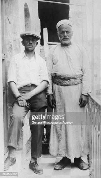An Arab man with one of the 22 Jews whose lives he saved by hiding them in his house during a massacre in Palestine probably the Hebron Massacre of...