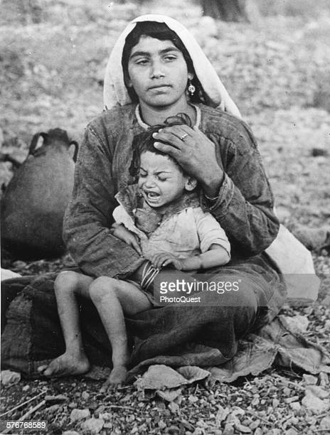 An Arab refugee mother and her child from the Ramallah region near Jerusalem Israel December 16 1948