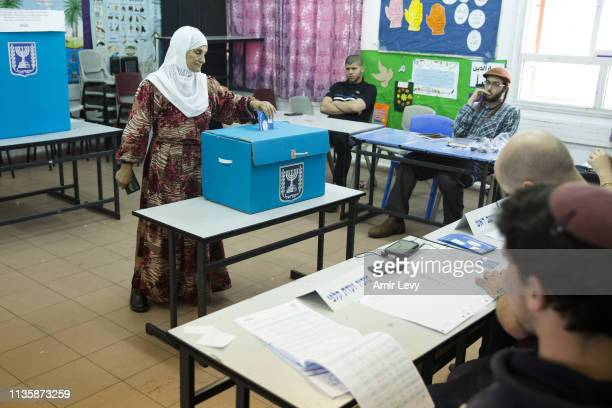 An arab woman casts her ballot in Israel's general elections on April 9 2019 in the village of Kafir Qasim Israel