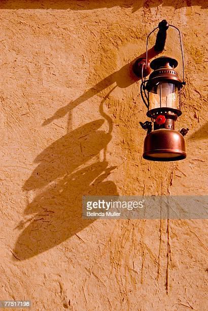 An Arabic Lantern reflecting it's Shadow on the Wall of a Room. Heritage Village, Dubai, United Arab Emirates