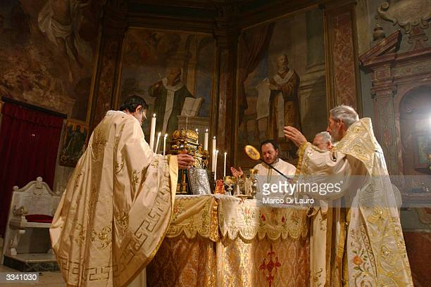 An Arbereshe priest celebrates the Easter Sunday Holy Mass April 11 2004 in Piana degli Albanesi Sicily Italy Piana degli Albanesi with approximately...