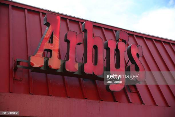 An Arby's restaurant sign is seen on November 28 2017 in Miami Florida Today Arby's Restaurant Group announced it reached a deal to acquire Buffalo...