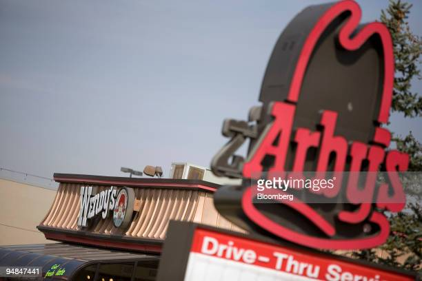 An Arby's restaurant sign stands near a Wendy's restaurant in Lakewood Colorado US on Thursday April 24 2008 Billionaire Nelson Peltz's Triarc Cos...