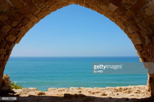 An arch at the turquoise Mediterranean sea