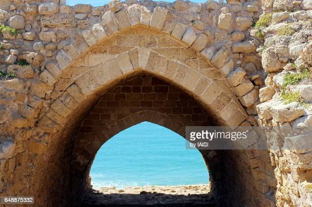 An arch at the turquoise Mediterranean, the archaeological site of Apollonia Arsuf