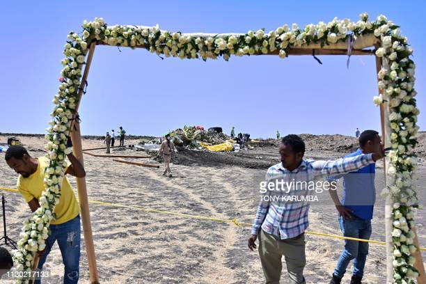 An arch of flowers is erected as officials prepare to receive families of the victims at the crash site of the Ethiopian Airlines operated Boeing 737...