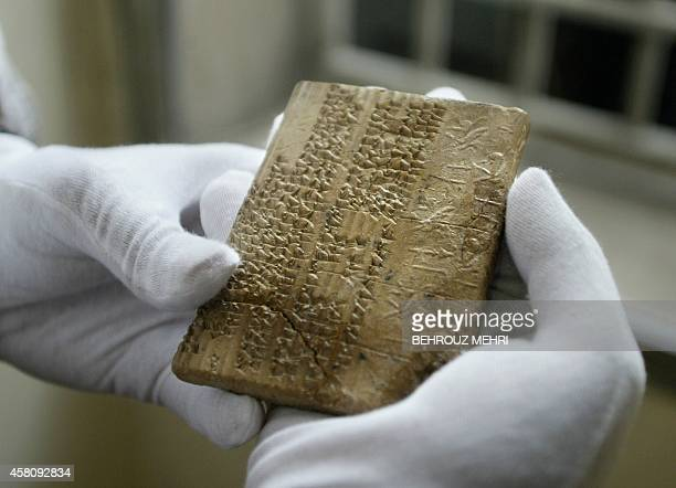 An Archaemenian clay tablet in the Elamite scripts which were written in cuneiform writing is shown at Iran's National Museum in Tehran 01 May 2004...