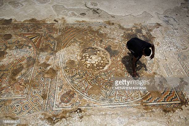 An archaeologist of the Israeli Antiquities Authority works on a 1500yearold Byzantine era mosaic floor near Kibbutz Beit Kama in the Israeli Negev...