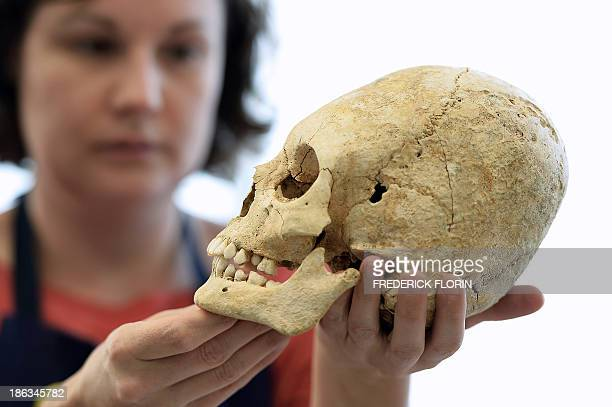 An archaeologist of the National Institute of Preventive Archaeological Researches presents a deliberately deformed skull of a 5th century barbaric...