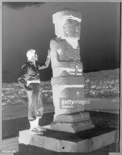 An archaeologist points to the cross on the right shoulder of a Tiwanakuan monolith statue which possibly dates back to around 800 BC The cross...