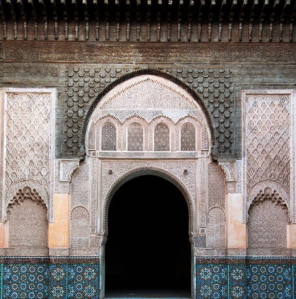 An Arched Doorway On A Building With Ornate Facade And Colourful Tile