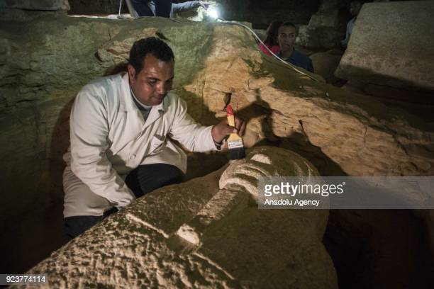An archeologist works on one of the 3000YearOld 8 pharaohs' tomb which were dug out during archaeological excavations in Minya Egypt on February 24...