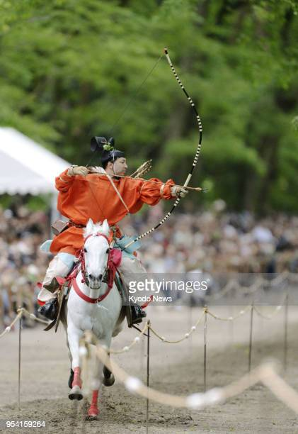 An archer aims for the target while riding a horse at the annual Yabusame Shinji rite at Shimogamo Shrine in Kyoto on May 3 2018 ==Kyodo