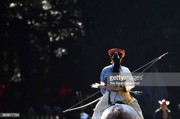 An archer from the Takeda School of Horseback Archery practices before a Yabusame archery demonstration on the grounds of the Meiji Shrine on...