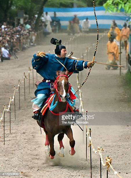An archer on a horseback takes aim during the Yabusame horseback archery ritual at Shimogamo Jinja Shrine on May 3 2015 in Kyoto Japan The ritual is...