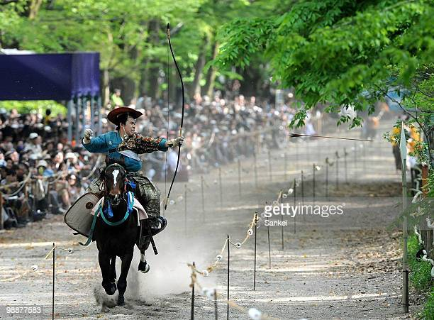 An archer on the horseback shoots an arrow during the Yabusame ritual at Shimogamo Jinja Shrine on May 3 2010 in Kyoto Japan The Yabusame began in...