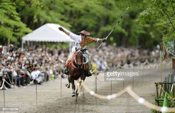 An archer shoots an arrow while riding a horse at the annual Yabusame Shinji rite at Shimogamo Shrine in Kyoto on May 3 2018 ==Kyodo