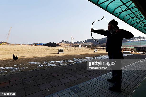 An archer takes target practice at an archery club which is to be relocated as construction continues at the Gyeongpo Oval and the Gangneung Hockey...