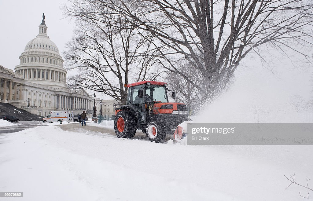 An Architect of the Capitol worker clears the sidewalks on the East Front of the Capitol on Monday, March 2, 2009.