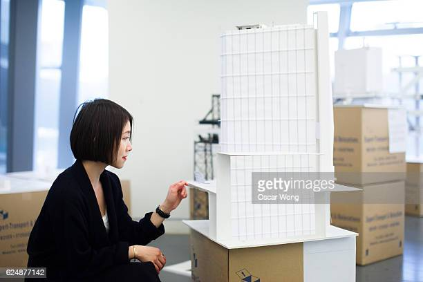 An architecture student making model in the campus