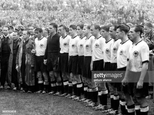 An archive picture dated 4 July 1954 shows the German national soccer team being honored in front of 53000 espectators after their victory of 32...