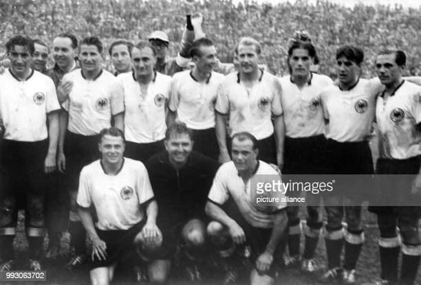 An archive picture dated 4 July 1954 shows the German national team after the victorious final match against Hungary during the soccer World...