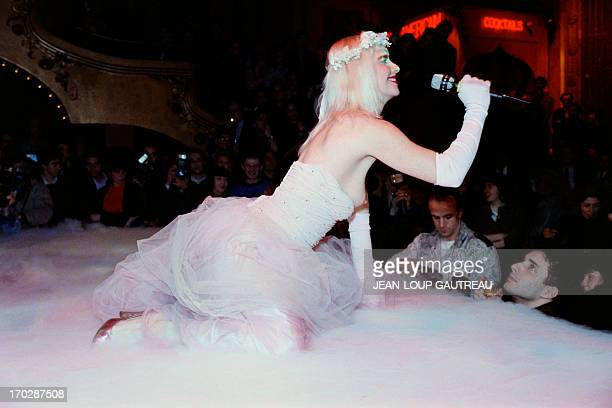 An archive portrait taken on January 28 1988 shows Ilona Staller known as Cicciolina Italian pornostar and member of Italian Parliament performing on...