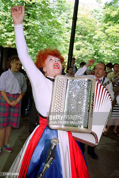 An archive portrait taken on July 11 1989 shows French accordionist Yvette Horner performing in the Tuileries Gardens in Paris AFP PHOTO JEANPIERRE...