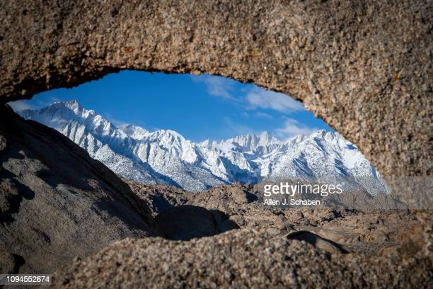 PINE CALIF WEDNESDAY FEBRUARY 6 2019 An archshaped hole in an Alabama Hills rock provides a a scenic view of snowcapped Mt Whitney and Lone Pine Peak...
