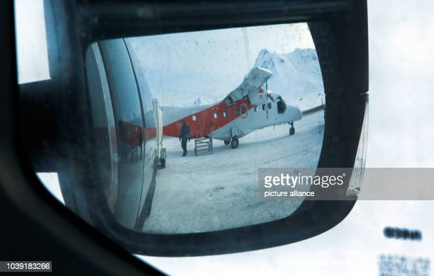 An arctic flyer can be seen in the sideview mirror of a shuttle bus in the Kings Bay Research Station on Spitsbergen in NyAelesund Norway 09 April...