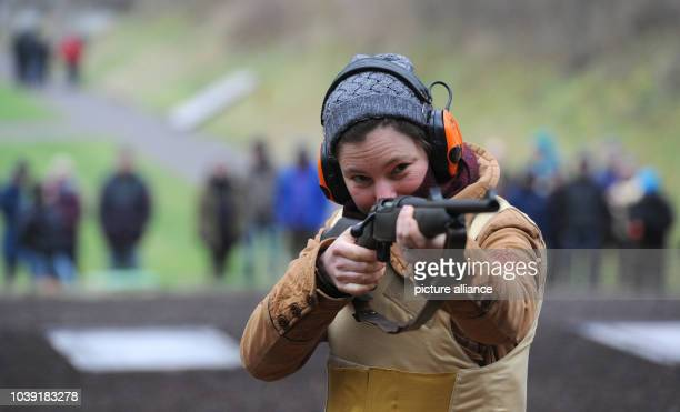 An Arctic reasearcher is instructed by a shooting instructor as she aims at a polar bear shaped target at a shooting range in Altenwalde Germany 28...