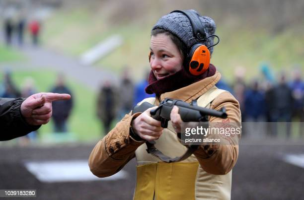 An Arctic reasearcher is instructed by a shooting instructor at a shooting range in Altenwalde Germany 28 January 2016 Scientists of the German...