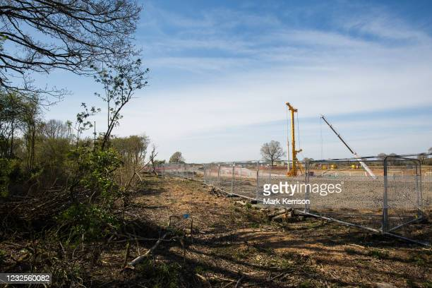 An area almost entirely cleared of trees and vegetation for the HS2 high-speed rail link is viewed from the remainder of Calvert Jubilee Nature...