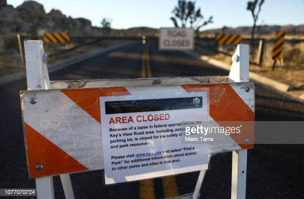An 'Area Closed' sign is posted in front of a closed section of road at Joshua Tree National Park on January 4 2019 in Joshua Tree National Park...