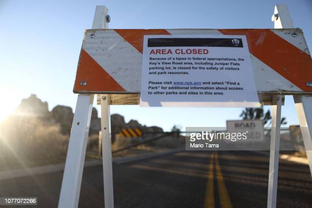 An 'Area Closed' sign is posted in front of a closed section of road at Joshua Tree National Park on January 4, 2019 in Joshua Tree National Park,...