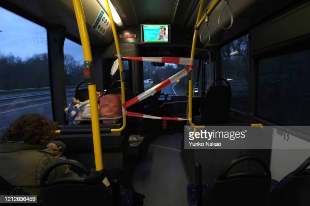 An area near the bus driver is cordoned off as a monitor shows an explanation on how to protect oneself from being infected nby the Corona virus on...