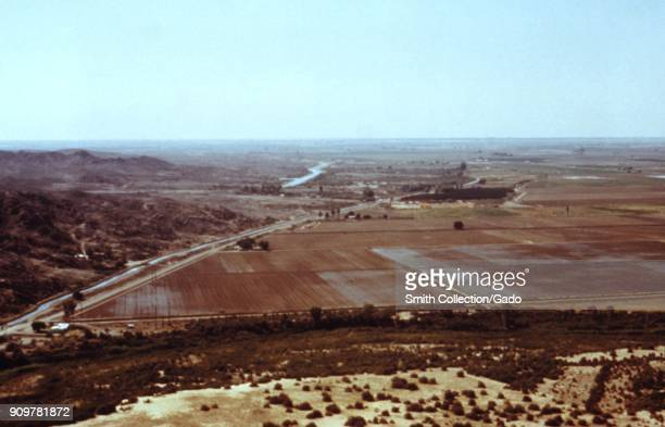 An areal photograph of fields with an irrigation canal in Arizona a site relevant to the CDC investigation of vectorborne diseases around water...