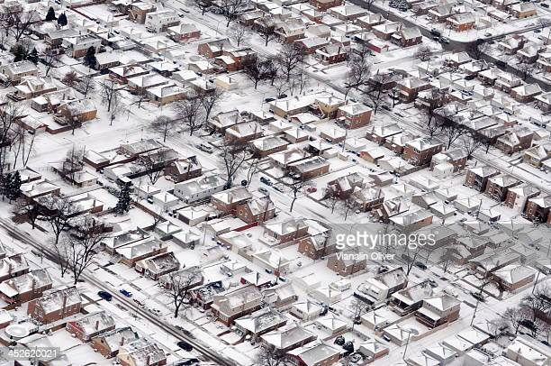 CONTENT] An areal view of Chicago neighborhood homes covered in snow