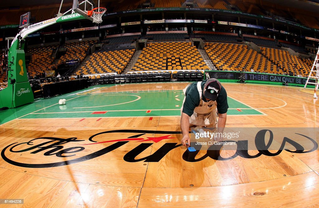 An arena worker makes preperations to the Finals logo on the court prior to Game Two of the 2008 NBA Finals between the Boston Celtics and the Los Angeles Lakers on June 8, 2008 at the TD Banknorth Garden in Boston, Massachusetts.