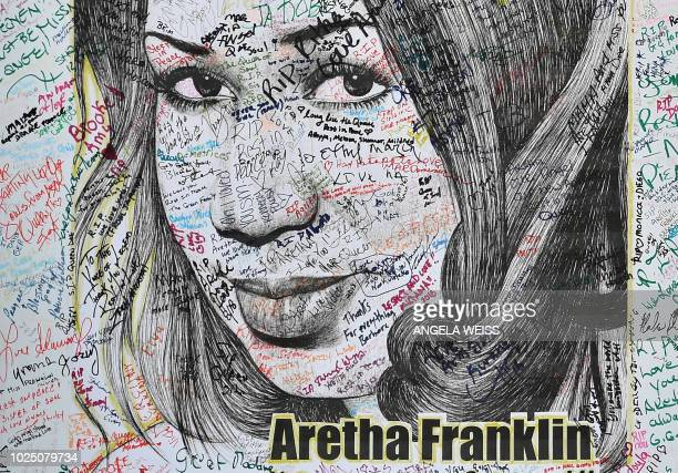 TOPSHOT An Aretha Franklin poster signed by fans is seen outside the Charles H Wright Museum of African American History on August 29 2018 in Detroit...