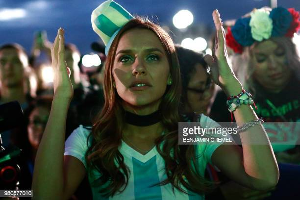 TOPSHOT An Argentina fan at the Fan Zone in Kazan reacts as she watches a live broadcast of the Russia 2018 World Cup football match between...
