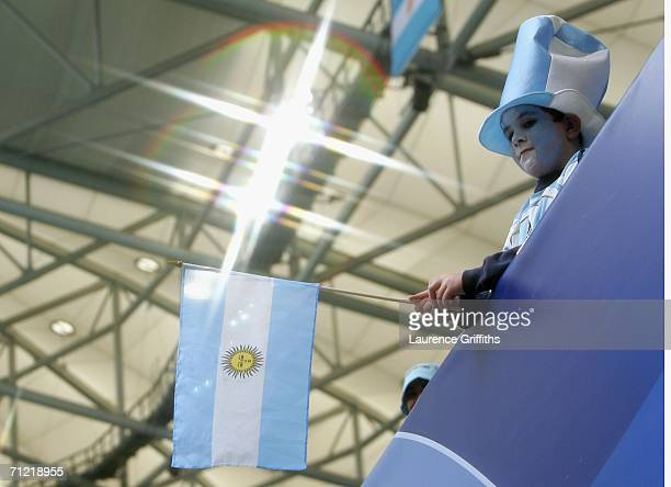 An Argentina fan holds a flag after the FIFA World Cup Germany 2006 Group C match between Argentina and Serbia Montenegro at the Stadium...