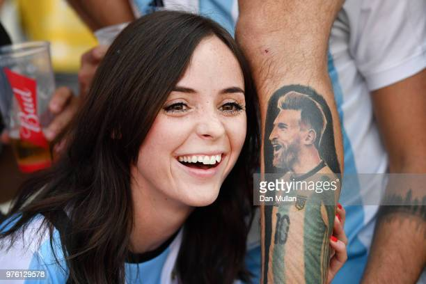 An Argentina fan poses with a fellow fans tattoo of Lionel Messi of Argentina prior to the 2018 FIFA World Cup Russia group D match between Argentina...